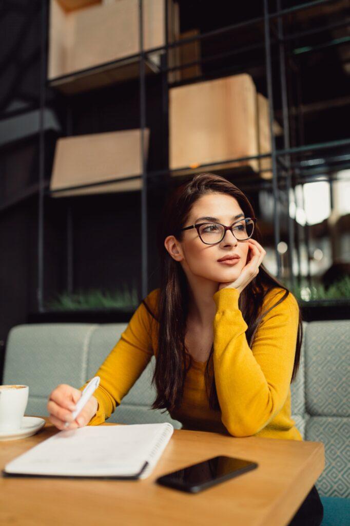 Young journalist on coffee break.